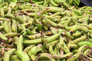 A pile of wasted big size green bananas
