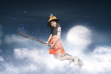 Happy asian witch girl flying on broomstick