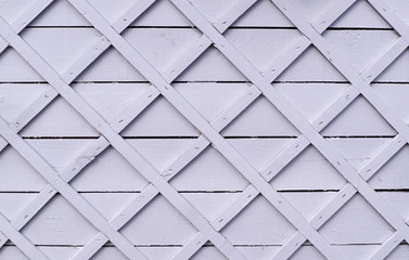 gray wooden fence with square lattice. background, texture.