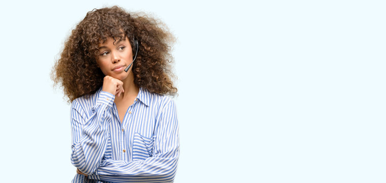 African american call center operator woman serious face thinking about question, very confused idea