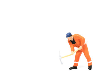 Miniature people worker wearing safety construction on white background with a space for text