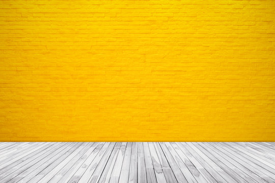 Yellow brick wall texture with wood floor background
