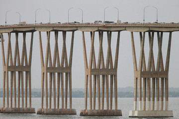 Cars drive along General Rafael Urdaneta Bridge, designed by Riccardo Morandi, in Maracaibo, Venezuela