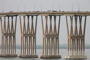 Cars drive along General Rafael Urdaneta Bridge, designed by Riccardo Morandi, in Maracaibo, Venezuela