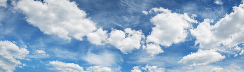 Wall Mural - white fluffy clouds on blue sky in summer on sunny day