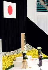 Japan's Emperor Akihito and Empress Michiko bow at an altar during a moment of silence to the war dead at a memorial ceremony marking the the 73rd anniversary of Japan's surrender in World War Two, at Budokan Hall in Tokyo