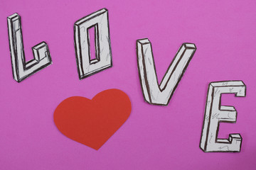 word love on pink background background with heart and engagement rings