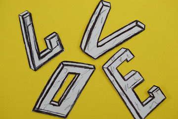 word love on a yellow background with a heart and engagement rings