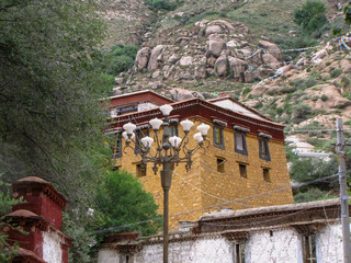 Traditional yellow house and lamppost near the Sera monastery, Lhasa, Tibet