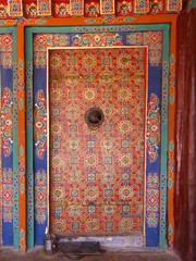 Colorful decorated closed door at Drepung monastery, Lhasa, Tibet
