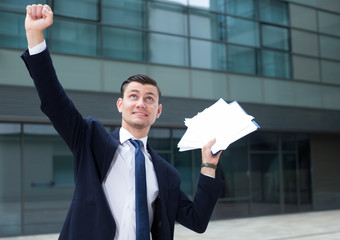 Professional businessman is happy after successful signing contract