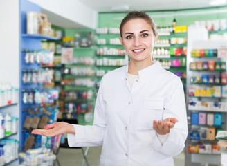 Female pharmacist standing in drugstore