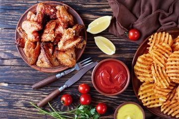 chicken wings and Crispy Potato, flat lay