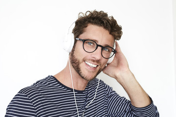 Handsome guy in spectacles and headphones, portrait