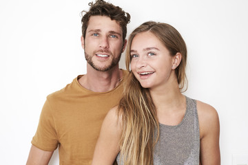 Couple with blue eyes smiling to camera