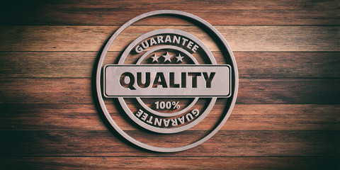 Round metal sign with text quality on wooden background. 3d illustration