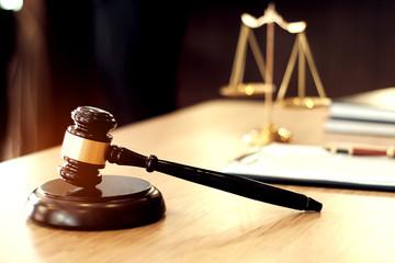 Judge gavel hammer on Lawyer desk.