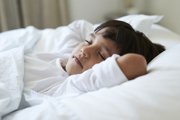 Fast asleep kid in bed, close up