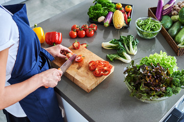 Chef cutting fresh and delicious vegetables for cooking.