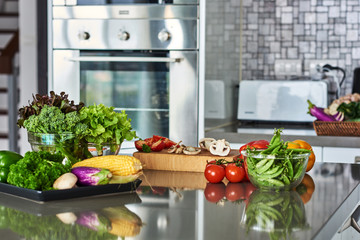 Healthy foods are on the table in the kitchen.