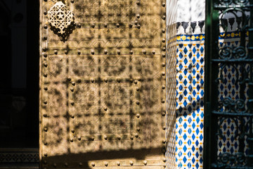 Zellige mosaic and tile work on traditional Moroccan brass door