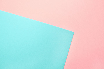 Abstract geometric water color paper background in soft pastel pink and blue trend colors.