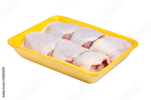Raw And Uncooked Chicken Thighs In A Yellow Plastic