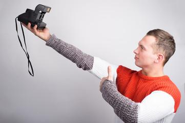guy makes selfies on old camera