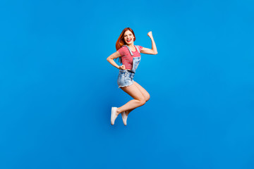 Full-size portrait of jumping happy girl who laughs and celebrat