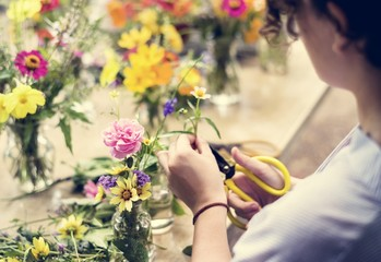 Woman preparing and arranging flowers
