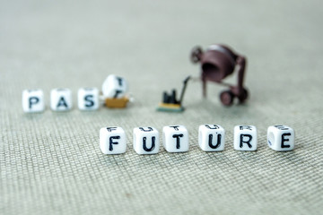 words past blurred and future sharp on grey background with miniature figurines