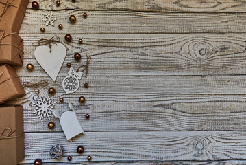 Beautiful Christmas composition with handmade gifts on wooden background with copy space.