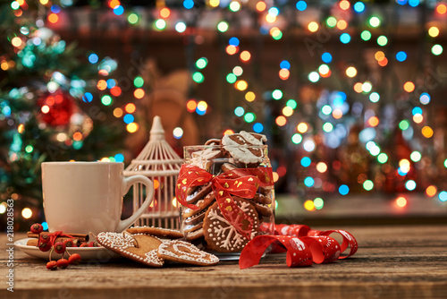Christmas composition. Cup of coffee, cinnamon sticks, gingerbread. Christmas background.