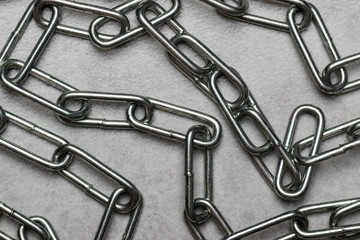 Metal chain on a concrete surface. Major links.