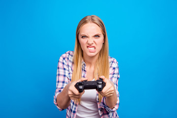 Close up of attractive blond woman holding joystick in hands and