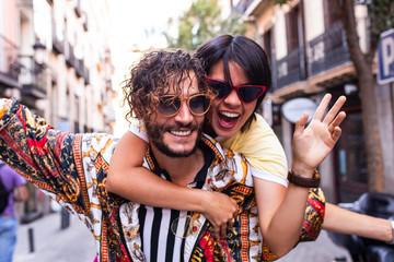 Stylish couple having fun on street
