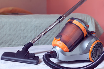 vacuum cleaner on a bedroom background.