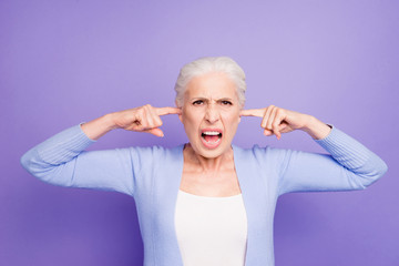 Beautiful angry gray-haired old lady wearing casual, closing her