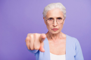 Portrait of beautiful angry gray-haired old lady wearing casual,