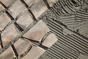 Old tiles recycling, making terrace or pavement using tile pieces, mortar and tile adhesive