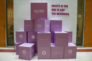 QVC parent Qurate Retail Group logo is displayed with other company brands at the QVC Studio Park in West Chester, Pennsylvania