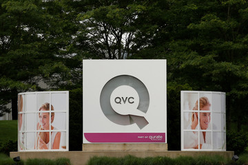 Signage is displayed at the entrance to the QVC Studio Park in West Chester, Pennsylvania