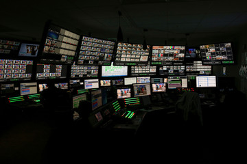 Producers work in a control room at the QVC Studio Park in West Chester, Pennsylvania