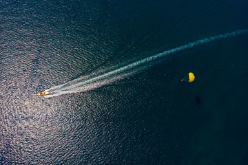 Aerial view of the boat and parachute in the sea