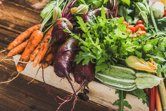 Bio organic vegetables on farmer market, farm fresh vegetable box on wooden background, vegetarian food concept
