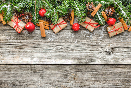 Christmas garland with decoration and christmas gift boxes on wooden background