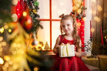 Cute girl in a christmas studio