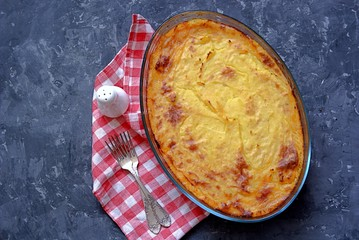 Shepherd's pie, traditional British casserole from mashed potatoes with minced meat and vegetables. Top view.