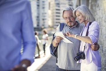 Senior couple taking a city break