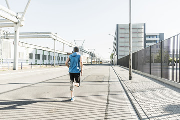Young athlete jogging in the city